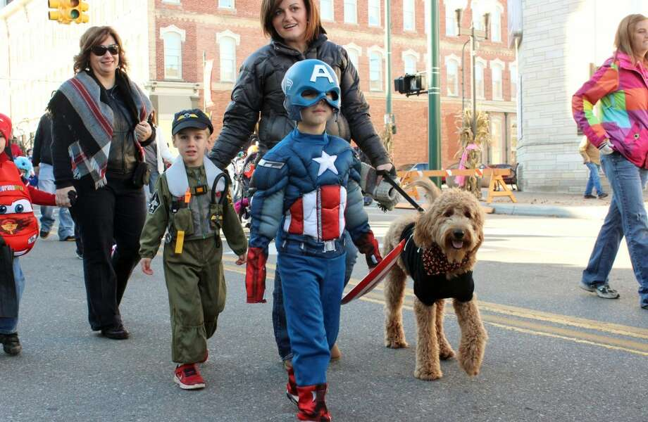 CAST OF CHARACTERS: Children, their parents and pets paraded through downtown Big Rapids on Saturday as part of the Fall Festival's costume parade. The two-day festival included a pumpkin rolling competition, a chili cook-off and much more. (Pioneer photos)
