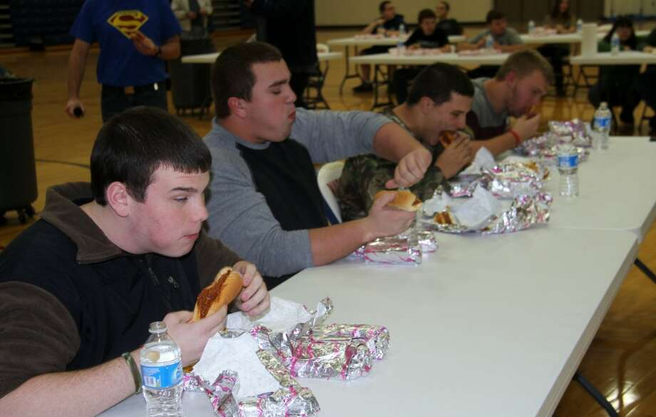 HEARTY APPETITES: High school boys chow down on their coney dogs. Thirty people joined the eating competition held Monday at Chippewa Hills Intermediate School. Profits from the event will go toward school field trips.