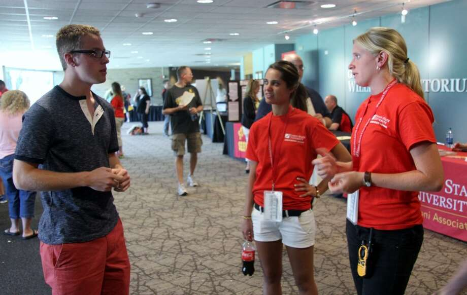 BULLDOG WELCOME: Ferris State University student orientation leaders answer questions from an incoming freshman during the university's first orientation session on Monday. Ferris will host 16 orientation events this summer to welcome freshmen, transfer students and their family and friends to campus. (Pioneer photo/Lauren Fitch)