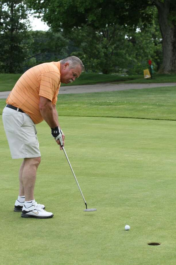 PUTTIN' AROUND: Paris resident Bill Johnson practices his putting before he and several friends golf at the Clear Lake Golf Club on Monday. The 18-hole course was purchased by John Currie, Chad Currie and Brennan Walsh in January and has seen success. (Pioneer photos/Eric Dresden)