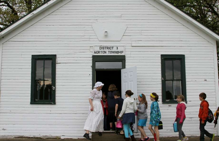 HISTORY LESSON: A class from Mecosta Elementary School spent the day at the historic Little River School House, located at School Section Lake Park, in May to experience the one-room schoolhouse environment first hand. (Pioneer file photo)