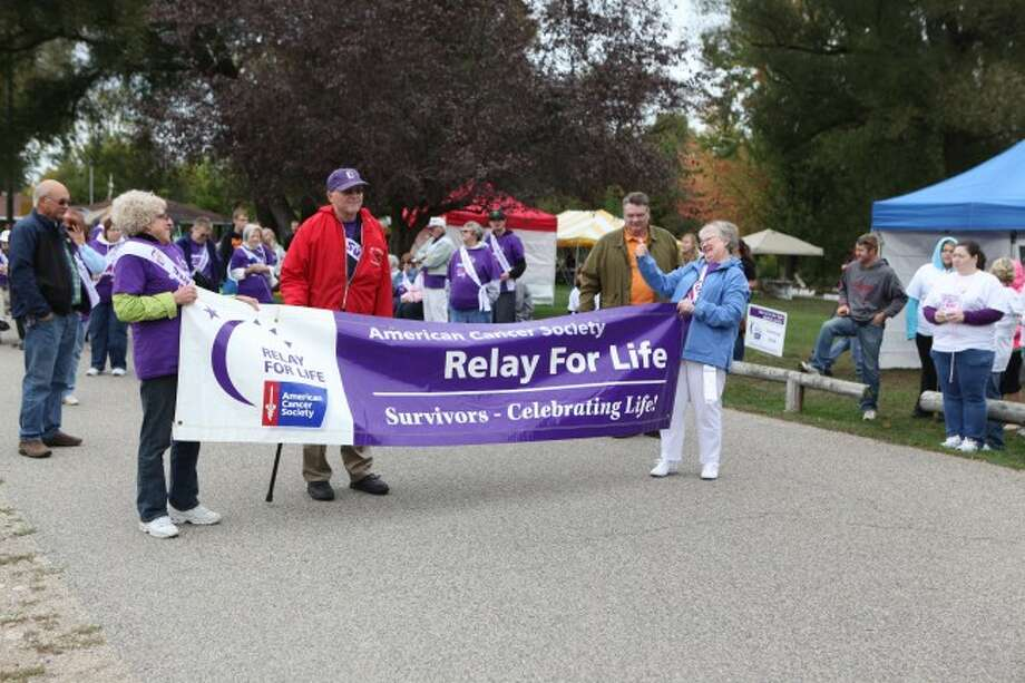 "SURVIVORS: Roughly 30 people walked during the ""Survivor Lap"" during Relay For Life on Saturday and Sunday in Hemlock Park."