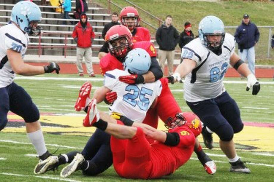 PHYSICAL PLAY: Ferris State linebacker Tayo Moss stops Northwood running back Jordan Jonker during second quarter action on Saturday. (Pioneer photo/Martin Slagter)