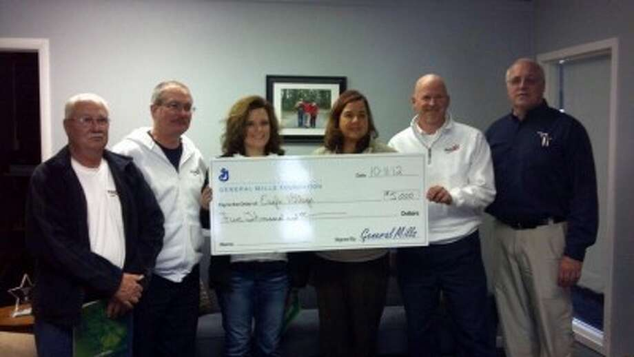 YOPLAIT FOUNDATION: Representatives from the General Mills Yoplait Foundation recently presented checks at schools and other organizations in Mecosta, Osceola and Wexford counties. The foundation donated a total of $130,000. (Courtesy photos)