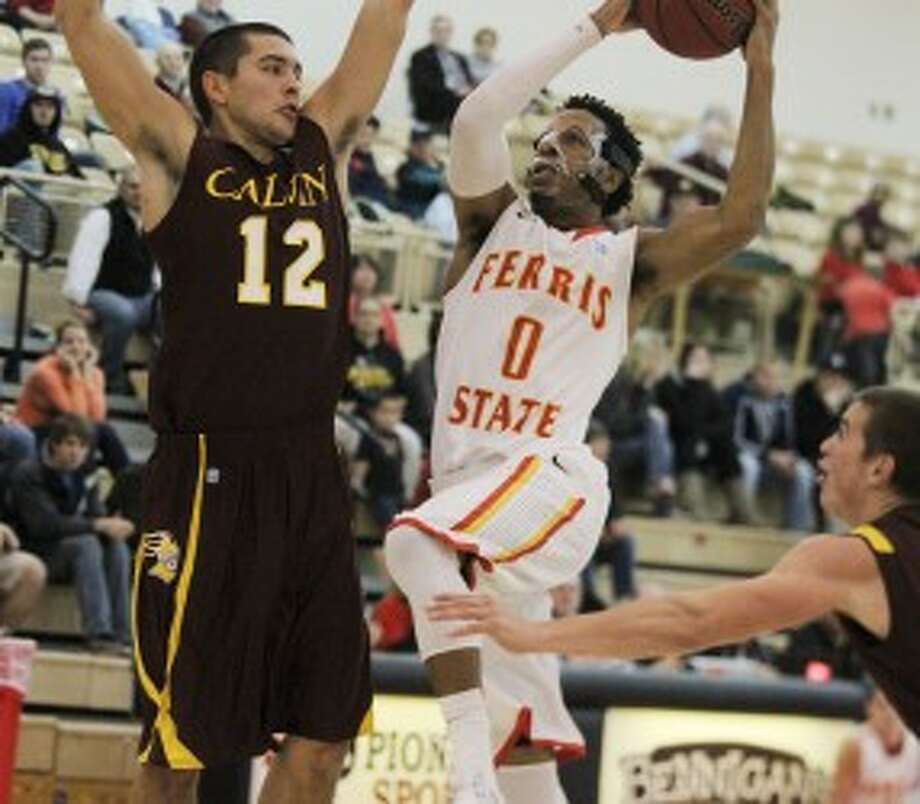 TO THE HOOP: FSU's Kenny Brown drives the lane during first half action against Calvin College. (Pioneer photo/Martin Slagter)