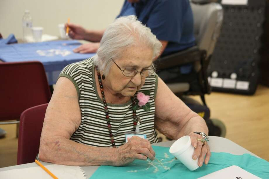 GETTING CRAFTY: SOAR member Rose Drayton uses a toothpick to create the sparks of a firework. (Pioneer photo/Miranda Roberts)