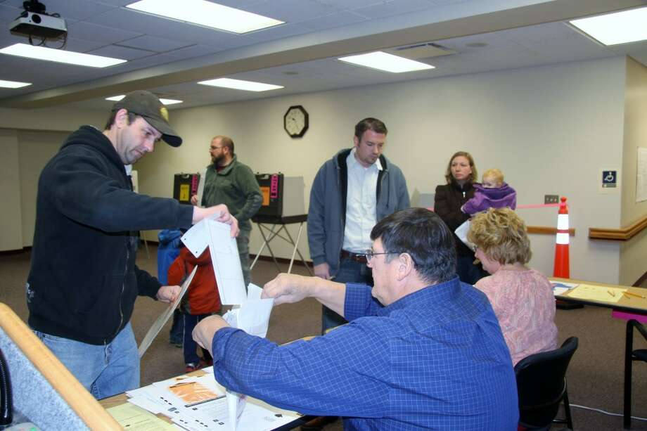 PUBLIC OPINION: Voters cast their ballots at Big Rapids City Hall on Tuesday. (Pioneer photo/Lauren Fitch)