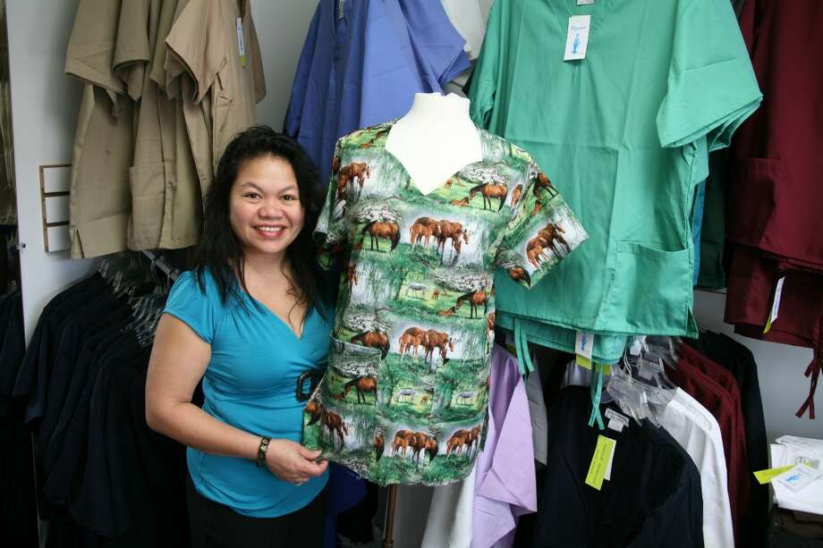 HANDMADE: Pazsian's Boutique owner Paz Schaub shows off medical scrubs she personally made. (Pioneer Photos/Eric Dresden)