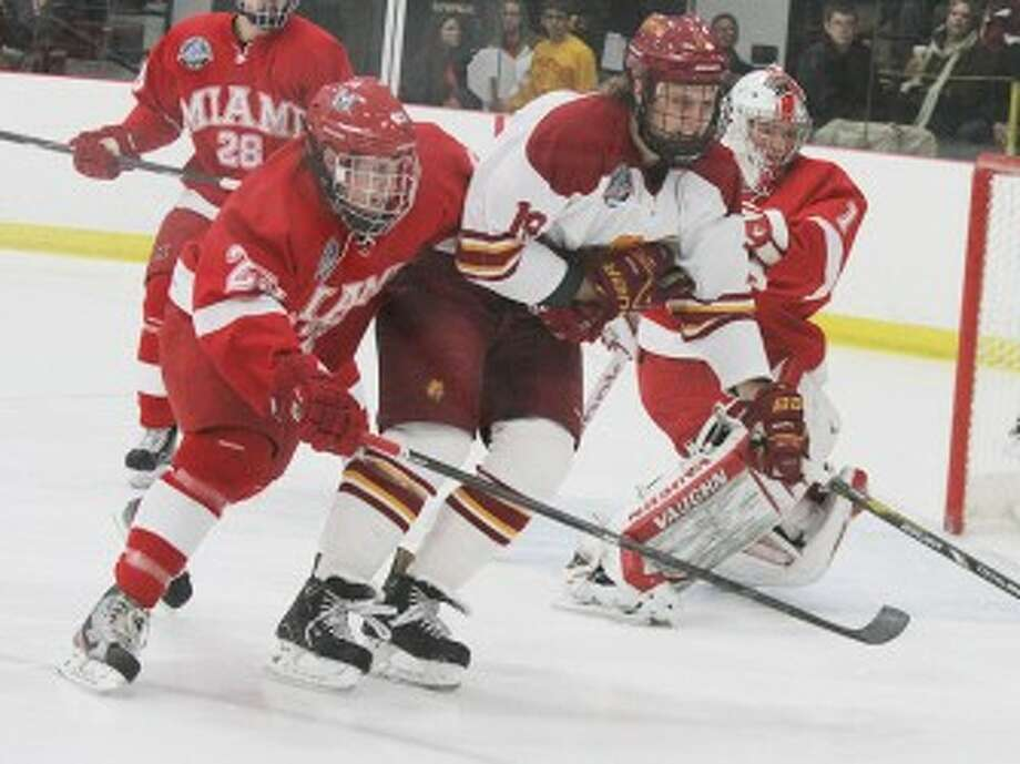 ROAD WARRIORS: Ferris State's Justin DeMartino goes after the puck during last weekend's action against Miami. (Pioneer file photo)