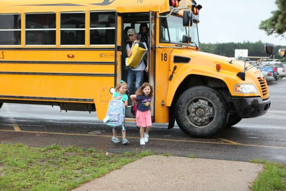 As local students get ready to return to school, police are encouraging people to exercise caution while driving. In addition to keeping an eye out for kids crossing the street, drivers also need to watch for buses making stops to pick up or drop off kids. (Pioneer file photo)