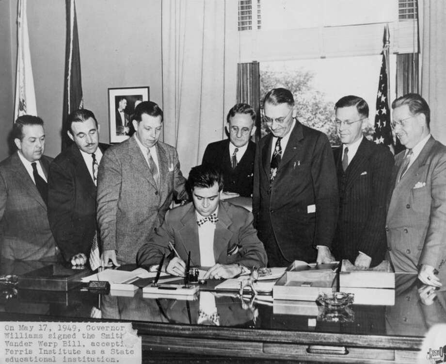"""PROGRESSION: Gov. G. Mennen """"Soapy"""" Williams and former Ferris State University President Byron J. Brophy sign a state college bill in 1949. (Courtesy photo)"""