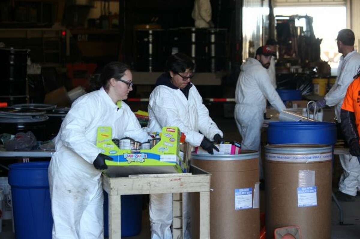 Officials with Drug and Laboratory Disposal collect hazardous chemicals from area residents on Saturday in Osceola County for the annual Clean Sweep and Household Hazardous Waste disposal day. Other disposal sites were set up in Mecosta and Lake counties. (Pioneer photo/Taylor Fussman)