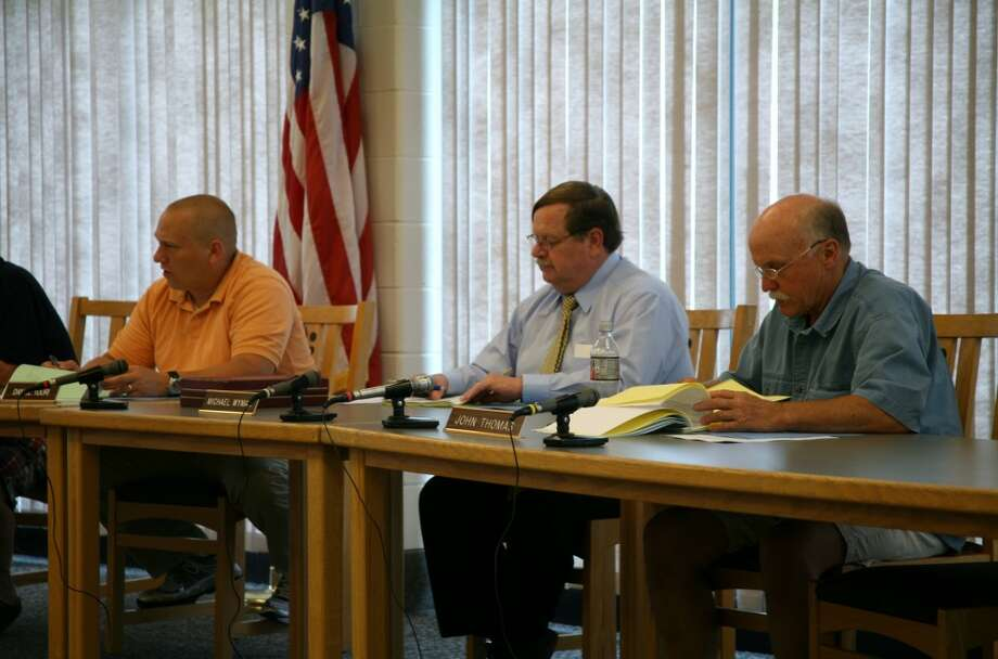 BUDGET REVIEW: (From left to right) Big Rapids Public Schools board of education member Dan Tuuri, secretary Michael Wyman and member John Thomas comment on the district's proposed 2013-14 budget at a special meeting on Thursday. (Pioneer photos/Lauren Fitch)