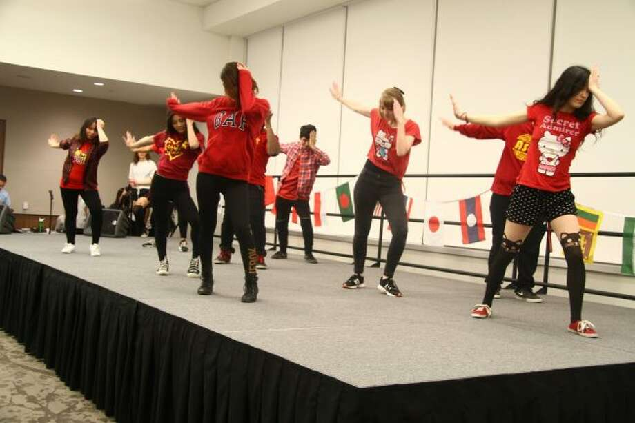 A group performs a K-pop dance during Sunday's 30th annual International Festival on Ferris State University's campus. K-pop, the abbreviation of Korean popular music or Korean pop, is a music genre originating in South Korea, characterized by a wide variety of audiovisual elements. (Pioneer photos/Emily Grove)