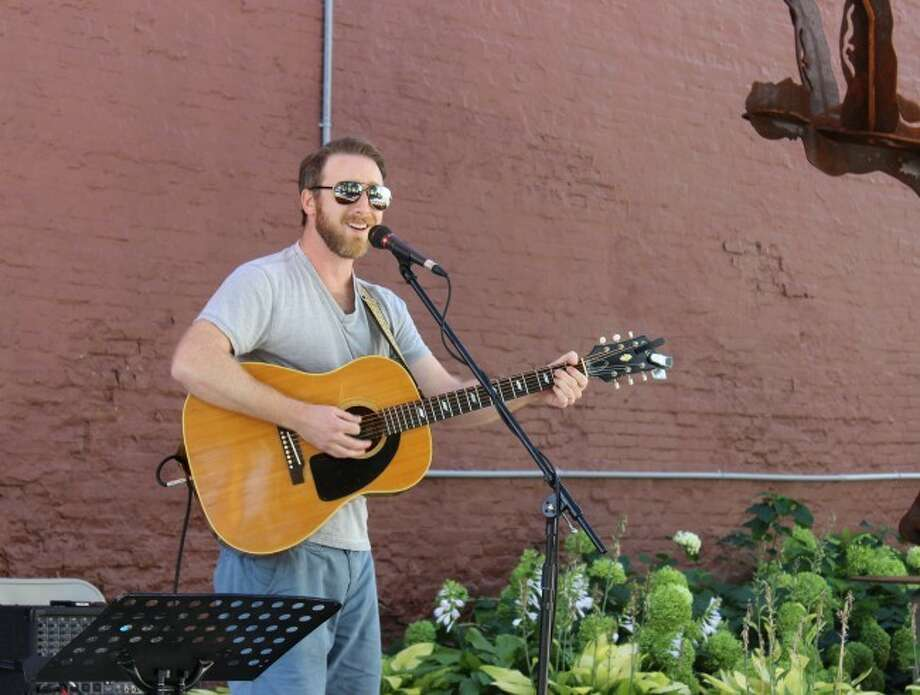 MUSIC: Andy Kirby performs for the Pocket Park Music Series in downtown Big Rapids. (Pioneer photo/Devin Anderson)