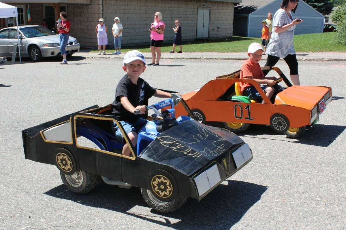 """PARADE: Children participate in the 2013 LeRoy Razzasque Days kid's parade in the village's downtown area. The parade's theme was """"the '70s."""" (Pioneer photos/Karin Armbruster)"""