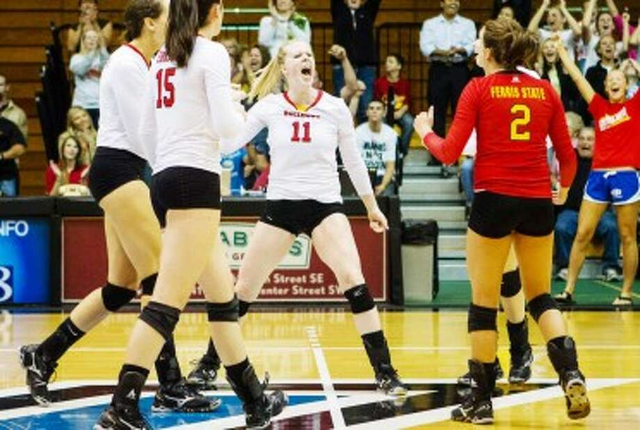 FIRED UP: Ferris State setter Samantha Fordyce (11) gets her teammates hyped up during volleyball action last season against Grand Valley State. (Courtesy photo)