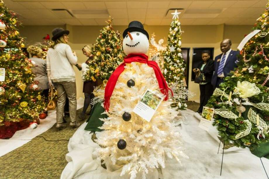 During a previous Festival of Trees, attendees browse the rows of Christmas decorations on the auction block. This year, the festival is set for Wednesday, Nov. 7, at the Holiday Inn in Big Rapids. (Pioneer file photo)