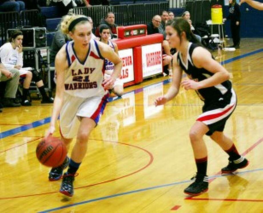 TO THE HOOP: Hannah Guy (left) and the Chippewa Hills girls basketball team will look to improve on last season's 5-16 record. (Pioneer file photo)