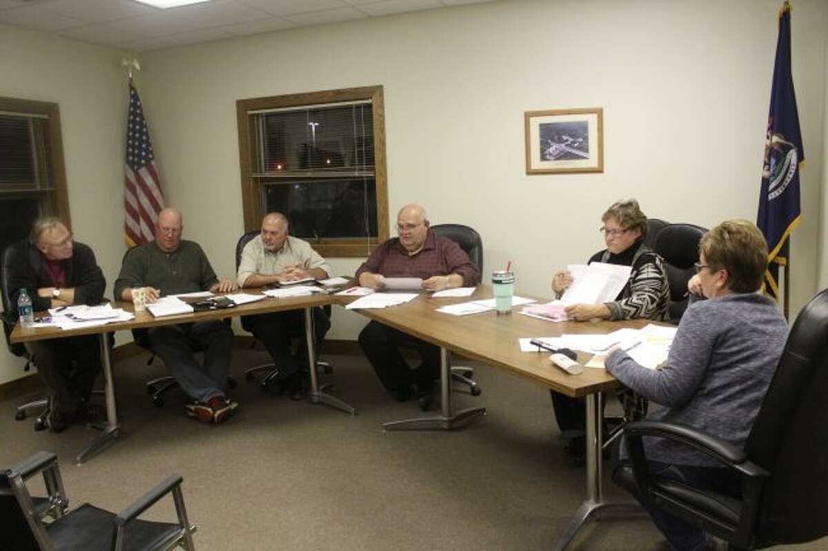 In this Pioneer file photo from Oct. 12, Big Rapids Charter Township officials meet to discuss the 2018 proposed budget. During a special meeting on Wednesday night, township officials set the 2018 wages for elected officials and employees, as well as approving the wastewater treatment agreement between Big Rapids Township, Green Charter Township and the City of Big Rapids. (Pioneer photo/Brandon Fountain)