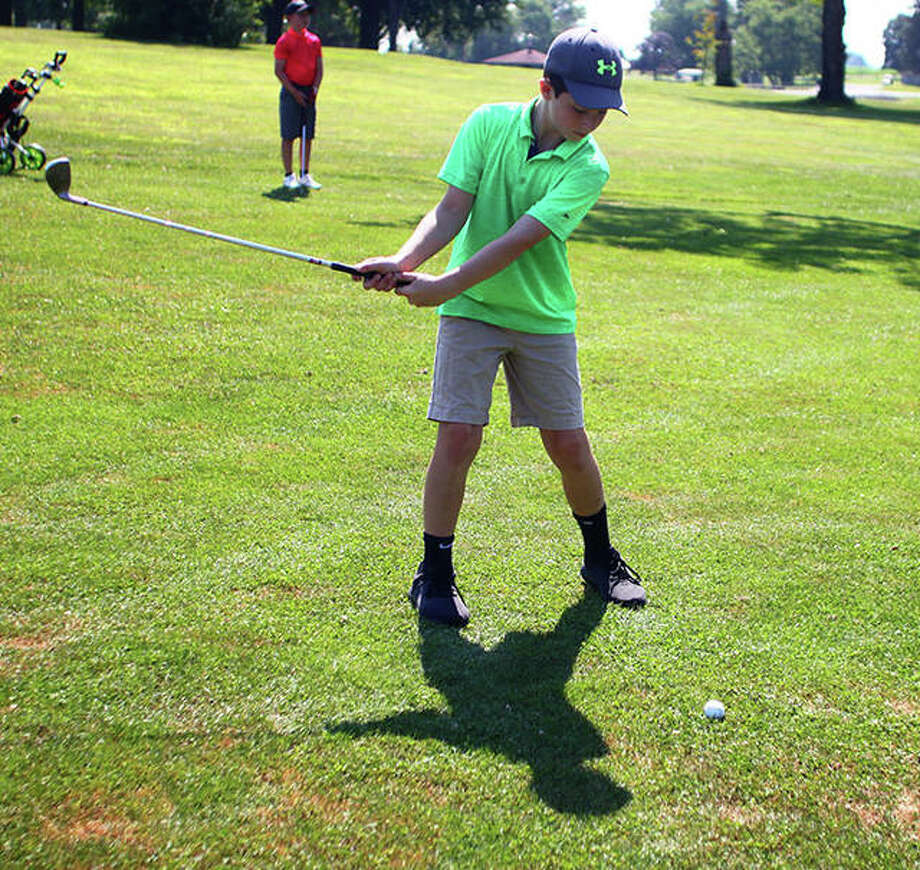 9-10 Boys player Evan Cors takes a swing at the ball during the Kiwansis Memorial Youth Golf Tournament in Jacksonville on Thursday. Photo: Rochelle Eiselt,  Journal-Courier