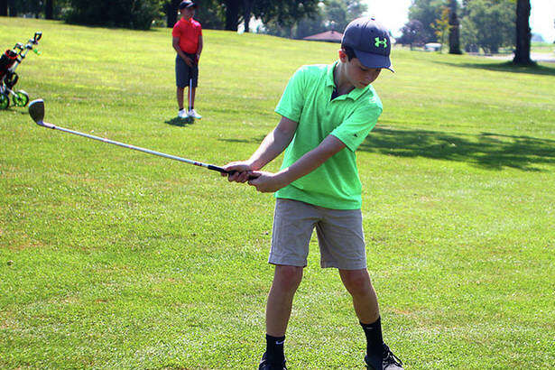 9-10 Boys player Evan Cors takes a swing at the ball during the Kiwansis Memorial Youth Golf Tournament in Jacksonville on Thursday.