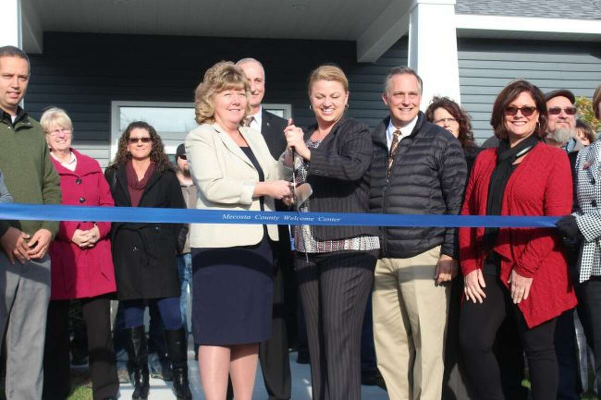 Mecosta County Convention and Visitors Bureau and Mecosta County Area Chamber of Commerce officials have a ribbon cutting ceremony on Wednesday as they hosted the grand opening of the Mecosta County Welcome Center. Dozens of area business, community and government leaders were on hand to celebrate the new building. (Pioneer photos/Brandon Fountain)