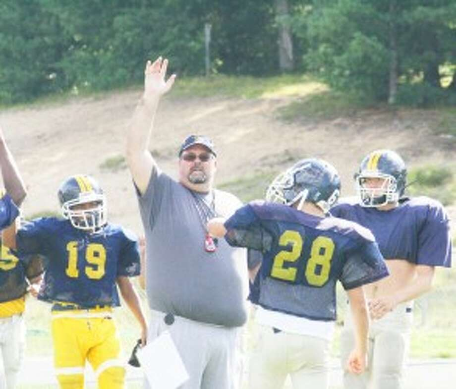HUDDLE UP: Doug Bolles and his Baldwin football players are ready to open practice on Monday. (Pioneer file photo)