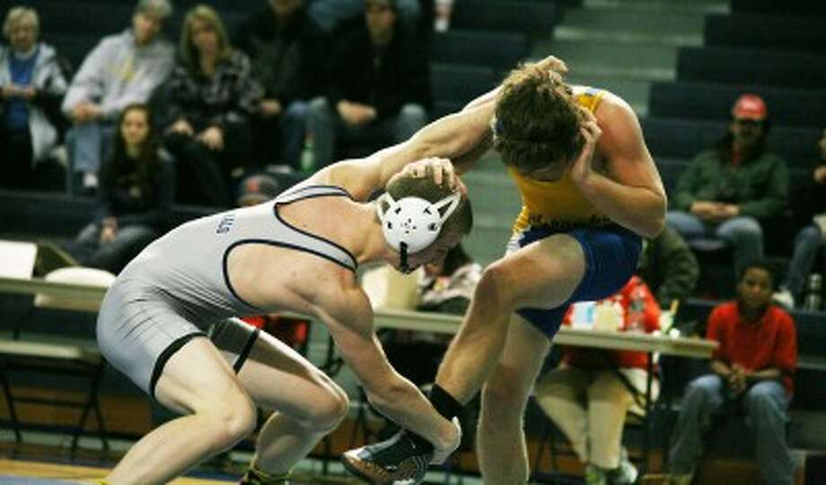 HEAD TO HEAD: Big Rapids' Jared Worden (left) looks to take down his opponent during Wednesday's high school wrestling action. (Pioneer photo/Bob Allan)