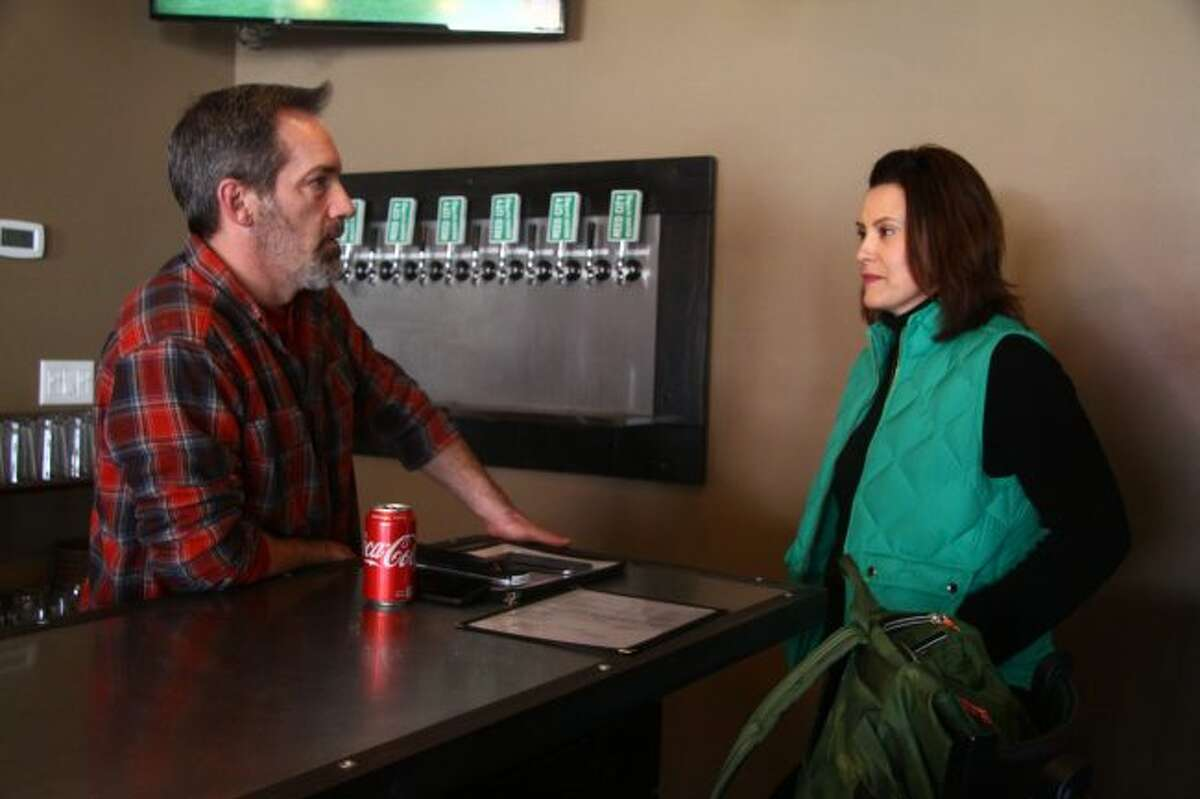 Kevin Murphy, owner of Reed City Brewing Company, chats with Gretchen Whitmer, a Democratic candidate for governor of Michigan, on Sunday at the brewery. Whitmer was visiting the area as part of her campaign, talking with residents and business owners about issues they felt she should focus on. (Pioneer photos/Emily Grove)