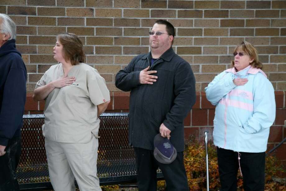 SHOW OF RESPECT: Spectrum Health Big Rapids Hospital employees say the pledge of allegiance during a Veterans Day ceremony on Monday.