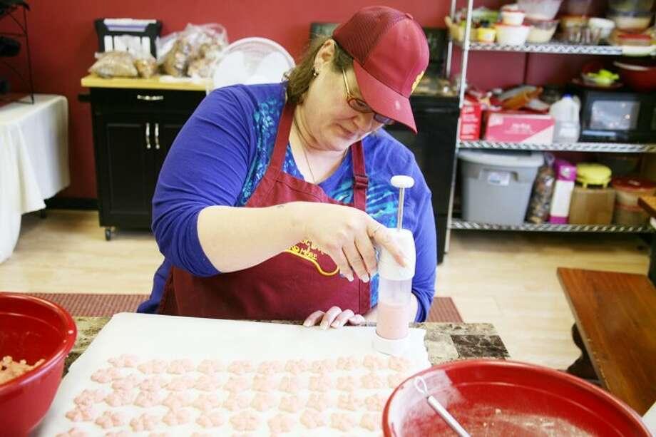 WORKING: Teresa Panek makes cherry star dog treats on Friday at Good Dog Bakery, located at 120 N. Michigan Ave. in Big Rapids.
