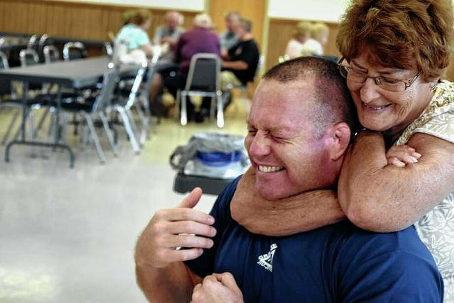Jared DeGroot (left) lets Glenda Anderson practice a chokehold on him during a senior self-defense class at the Community Park Center Thursday. Reprints of this and other Journal-Courier photos are available at journal-courier.dotphoto.com.