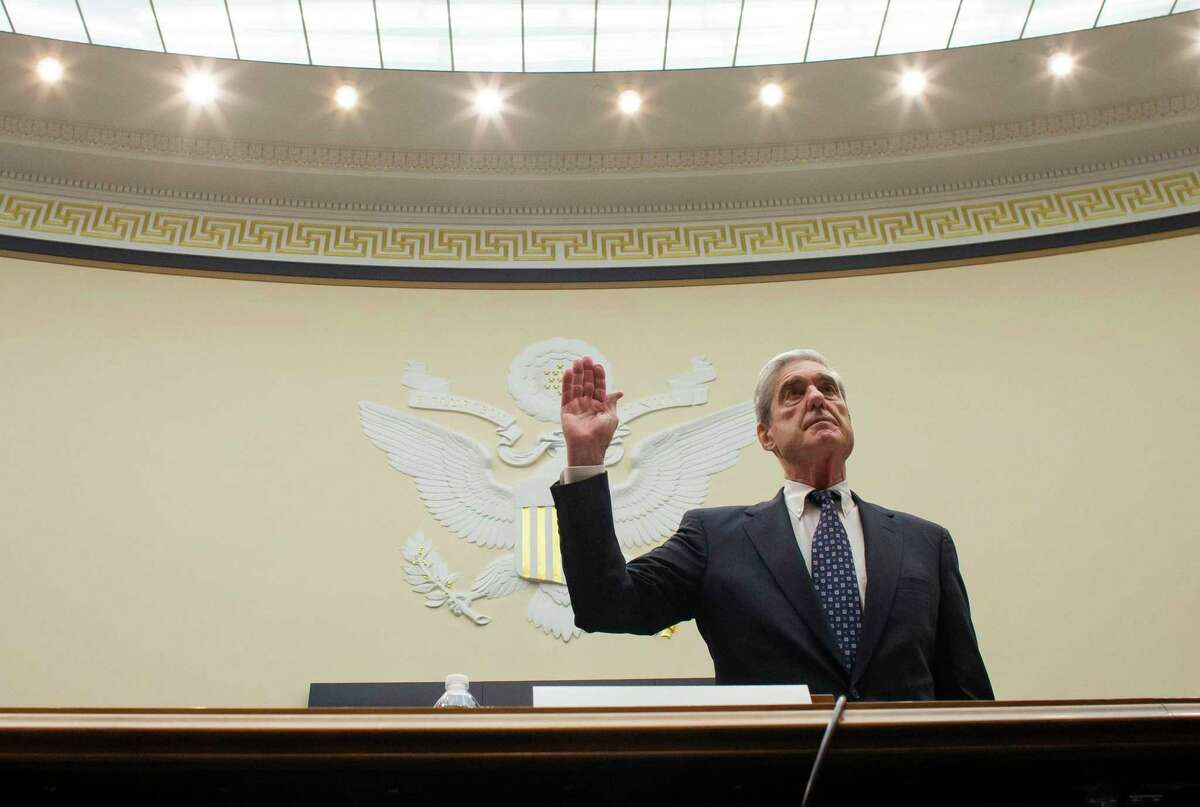 Former special counsel Robert Mueller is sworn in to testify before the House Judiciary Committee hearing on his report on Russian election interference, on Capitol Hill, Wednesday, July 24, 2019 in Washington. (AP Photo/Alex Brandon, Pool)