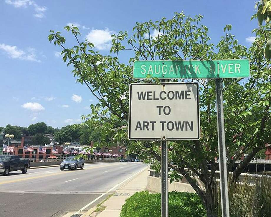 """A sign reading 'Welcome to Art Town"""" near the Post Road bridge in downtown Westport. Photo: Miggs Burroughs / Contributed Photo"""