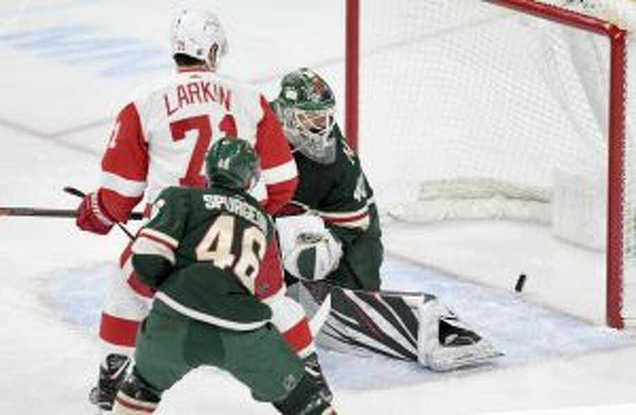 Minnesota Wild goalie Devan Dubnyk, left, Detroit Red Wings' Dylan Larkin (71) and Wild's Jared Spurgeon (46) watch the goal of the Detroit Red Wings' Gustav Nyquist, of Sweden, go into the net in the first period of an NHL hockey game Saturday in St. Paul, Minn. (AP Photo/Tom Olmscheid)