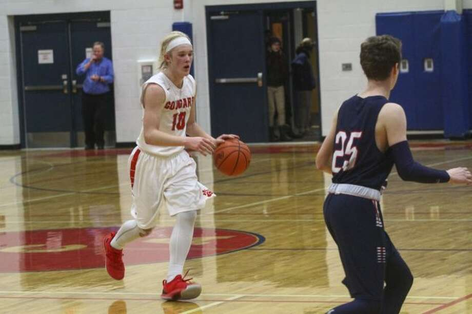 CCA forward Jackson Wickes moves the ball up the court for the Cougars during Thursday's game. (Pioneer photo/Maxwell Harden)