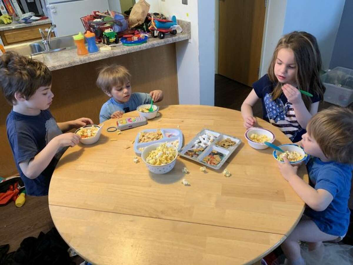 Pictured from left are the Franklin family; Tobias, 5, George, 2, Suzy, 5, and Jamie, 2, of Big Rapids. Their mother, Jackie, has been putting on theme parties all week for the kids to help cope with cabin fever. (Courtesy photo)
