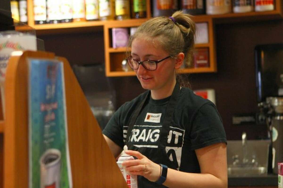 Kaitlin Daly, a student at Ferris State University, works at Biggby Coffee while she double majors in nursing and health information technology. Daly said while she loses some sleep, she likes her busy schedule. (Pioneer photos/Meghan Gunther-Haas)