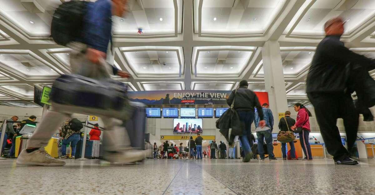 Travelers make their way through Terminal A at Bush Intercontinental Airport last year.
