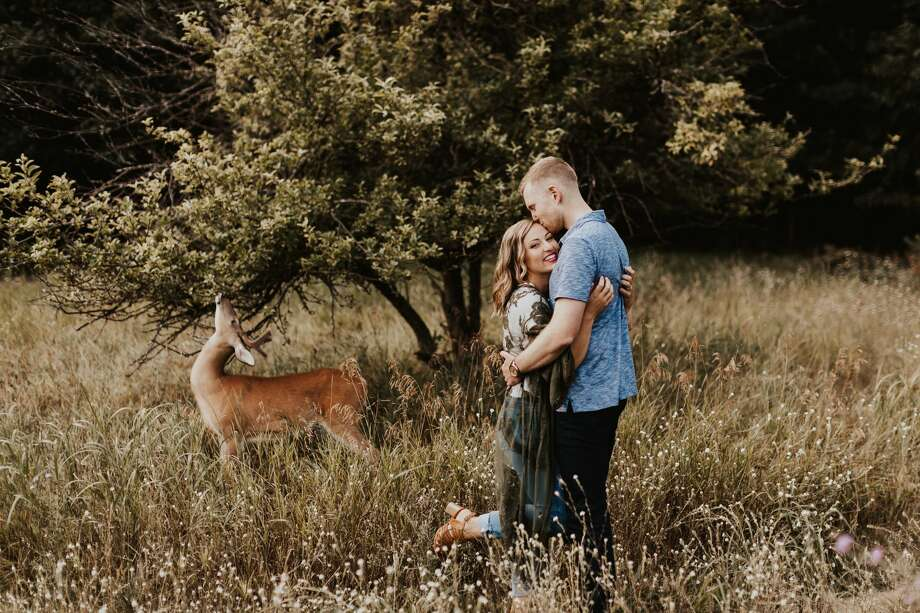 A surprise visitor wanders onto the Michigan engagement photo session of Dori Castignola and Austin Swiercz. Photographer Eldina Kovacevic of Inna Kova Photography said she told the couple to stay calm as she captured the moment. Photo: Eldina Kovacevic | Inna Kova Photography