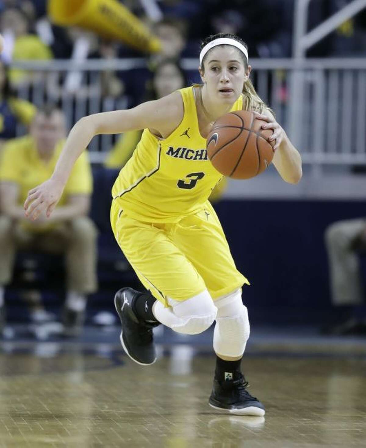 In this Feb. 19, 2017, file photo, Michigan guard Katelynn Flaherty brings the ball up court during the first half of an NCAA college basketball game against Michigan State in Ann Arbor, Mich. No player at Michigan, male or female, has scored more points than Flaherty. The 5-foot-7 senior has helped the Wolverines become competitive with some of the top teams in the Big Ten. (AP Photo/Carlos Osorio, File)