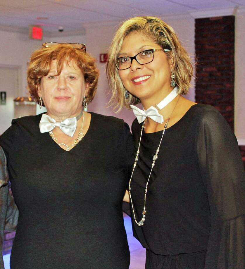Middlesex United Wayfinancial assistant Tracy Raicik, left, and administrative assistant Maria Wood are shown at the annual roast in 2018. Photo: Contributed Photo