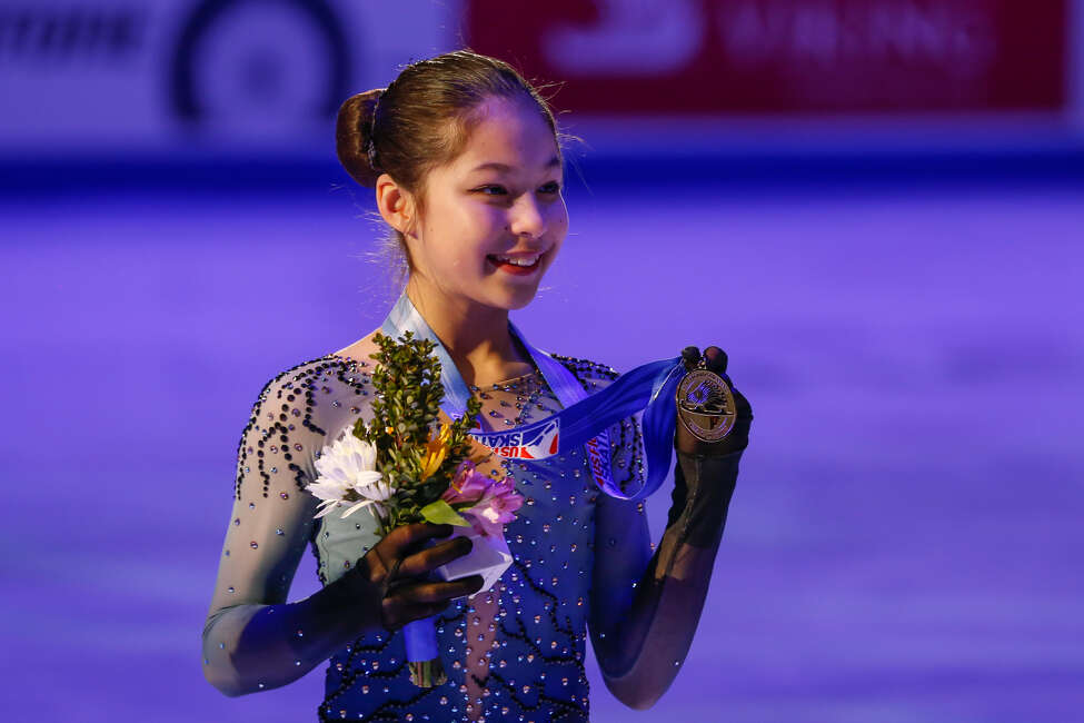 Alysa Liu poses for photographs during the awards ceremony after winning the ladies national title during the 2019 Geico U.S. Figure Skating Championships at Little Caesars Arena on January 25, 2019 in Detroit, Michigan. (Photo by Scott W. Grau/Icon Sportswire via Getty Images)