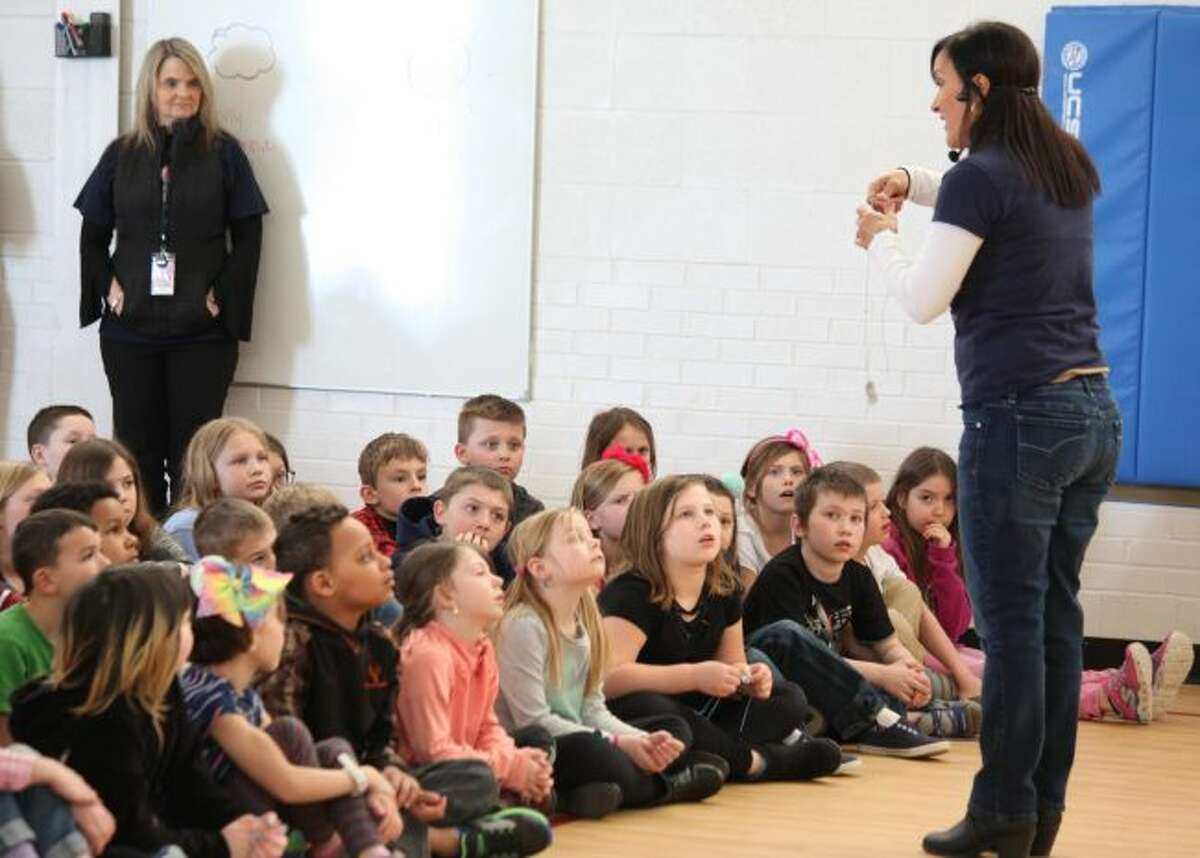 """Children's book author Elisa Camara visited Riverview Elementary School Monday afternoon to read her book """"Patriot Pup"""" to students. She explained the book teaches young readers the definition of patriotism, American traditions and the importance of respecting veterans. (Pioneer photos/Taylor Fussman)"""