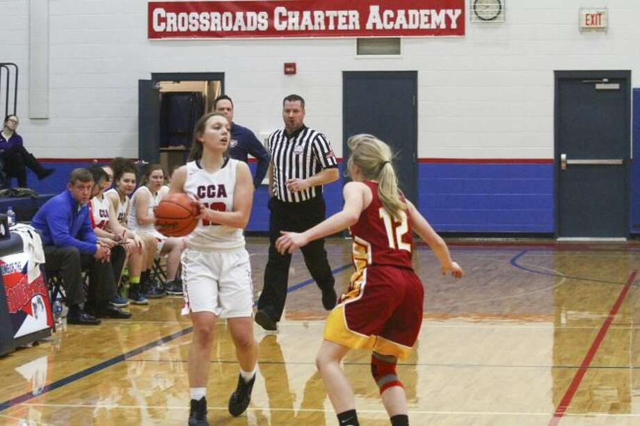 CCA's Allie Angell (12) looks for an open teammate during Wednesday's district game. (Pioneer photo/Maxwell Harden)