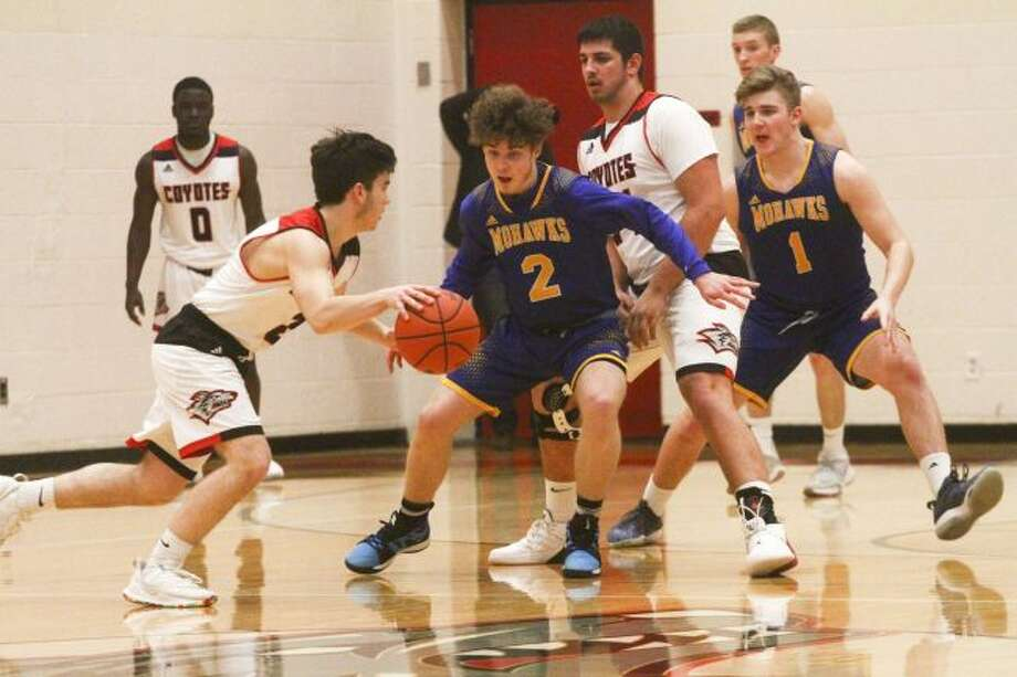Junior guard Axel Woolworth (2) and senior forward Trevor Underhill (1) were key components to Morley Stanwood's success. (Pioneer file photo)