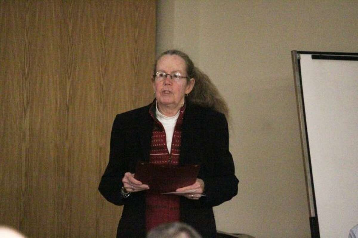 Big Rapids City Commissioner Lynn Anderson reads a city proclamation during Monday's city commission meeting proclaiming Feb. 14 as Anna Howard Shaw Day. (Pioneer photo/Brandon Fountain)