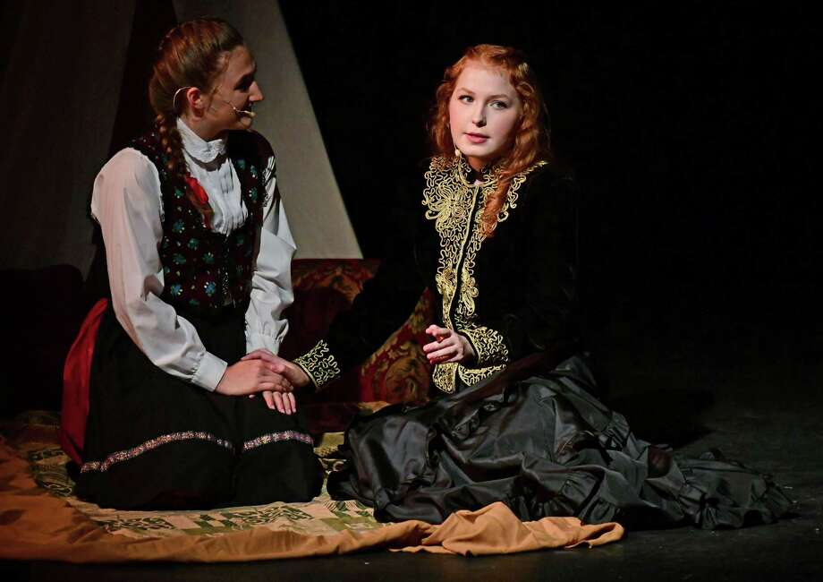 Lauren Kelly plays Marika and Emma Rogers plays Ikona as Crystal Theater and the Liget Dance Ensemble of Budapest perform in Hungarian Nights Wednesday, July 24, 2019, at the theater in Norwalk, Conn. The company gave the preview perfromance before heading to New York City's A.R.T Theater for two perfromances. Hungarian Nights returns in a further developed version starring Cidalia Kettles (of Fairfield) as Zsofia, the gypsy seer—a role she originated in the world premiere 2010 production. It also stars Sam Patterson (of Norwalk), returning in his role as the secret vampire, Count Dráko Batthány de Harkály and Emma Rogers (of Weston) as his erstwhile former wife, Ilona and Crystal Theatre vocal teacher/director Joseph Santaniello as János, the gypsy king. Encore performance in Norwalk is scheduled for Saturday, July 27th at 7:30 PM. Tickets available online at crystaltheatre.ticketleap.com/preview-night---hungarian-nights---norwalk-show/ Photo: Erik Trautmann / Hearst Connecticut Media / Norwalk Hour