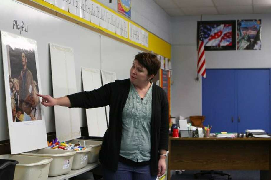 Picture Lady Emily Theunick teaches St. Mary Catholic School fifth- and sixth-graders about one of the Four Freedoms series paintings by Norman Rockwell. The painting is known as the Freedom of Speech. (Pioneer photos/Meghan Gunther-Haas)